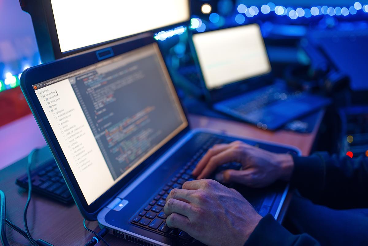 programmer-hands-on-keyboard-network-security-RRWPEHR-edited